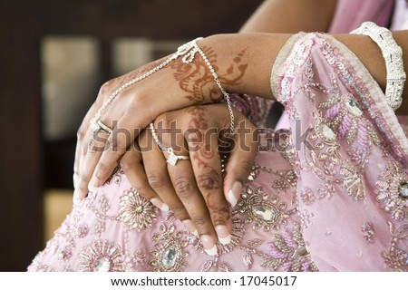 stock photo : Bride's Hand With Henna Tattoo And Jewellery, Indian Wedding