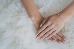 bride's hands on a white wedding dress