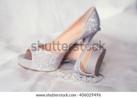 Bride's high heel shoes and jewelry. Wedding illustration image. #406029496