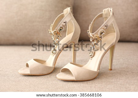 Bride's high heel shoes on sofa #385668106