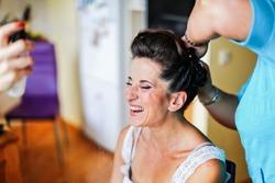 Bride's morning. Process of makeup artist preparing the bride before wedding