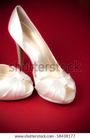 Bride's shoes on red background