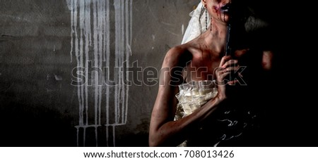 Stock Photo bride violence suicide holding handgun or ghost woman with blood skin is screaming darkness and nightmare wall, horror of scary fear on hell is monster devil girl in halloween festival concept