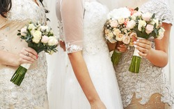 Bride wearing gorgeous wedding dress, with bridesmaids posing.