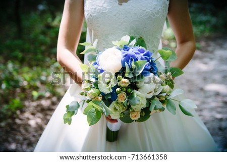 bride with a bouquet #713661358