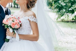 Bride with a bouquet in hands
