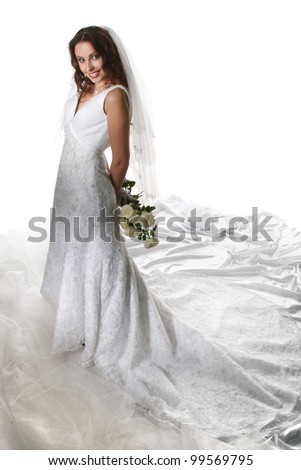 bride with a veil on a walk in the park - stock photo