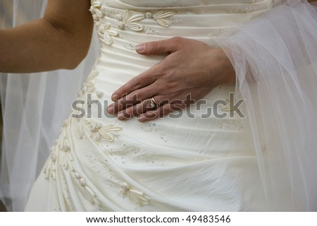 stock photo Bride with her new ring Engagement and wedding band on the