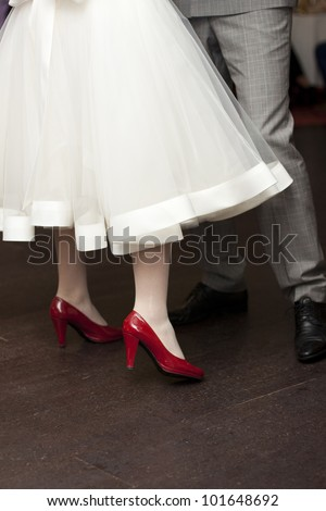 Bride with red shoes dancing