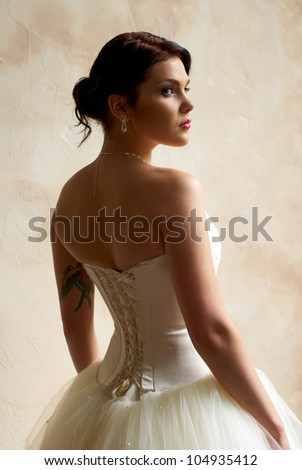 bride with tattoo posing in the room