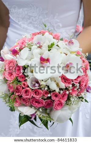 Bride with wedding bouquet - stock photo