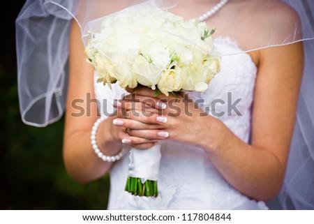 Bride with wedding  bouquet, closeup