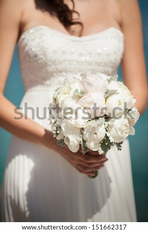 bride with wedding bouquet  peony flowers. Bridal flowers at wedding day. beautiful bouquet of marriage flowers. wedding decoration.beige and white wedding flowers. peony bouquet at summer wedding