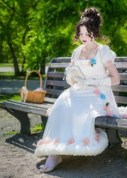 bride woman in a white dress with a book in hands.