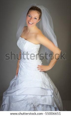 Bride woman in wedding dress in studio