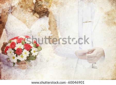 Bridegroom and bride holding beautiful red roses wedding flowers bouquet. Photo in old colour image style.