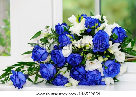 Brides bouquet of blue and white roses