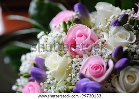 Brides bouquet with pink roses closeup
