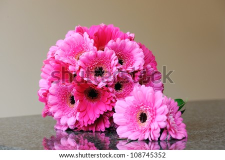 Brides pink bouquet and grooms buttonhole
