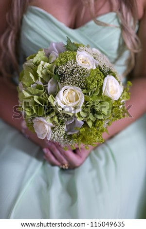 bridesmaid holding green wedding bouquets