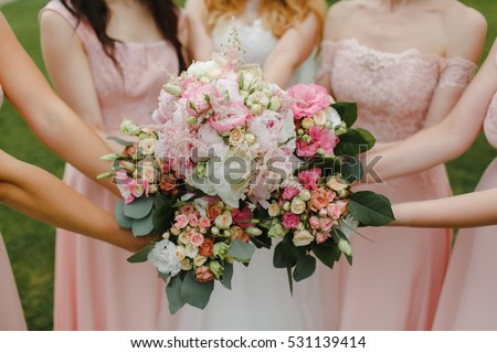 bridesmaids holding bouquets at the center