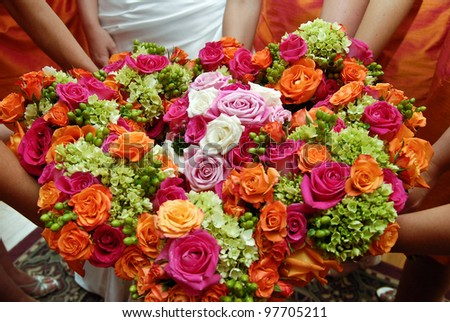 Bridesmaids holding wedding bouquets in a circle