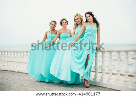 Bridesmaids on the seaside in blue dresses