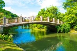 bridge across a stream in the park