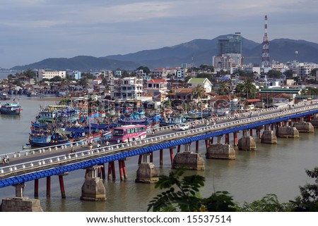 Bridge and boats in Nha Trang, central Vietnam
