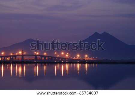 Bridge and light in the morning at Tunis lake