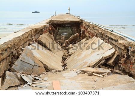 Bridge collapse on the beach - stock photo