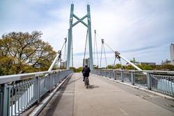 Bridge constructed of iron only for pedestrian, in the park.bridge, pedestrian, valley, suspension, clara, modern, transportation, bay, trail, blue, area, footbridge, sky, river, architecture, structu