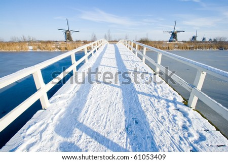 Bridge covered with snow on a winterday in Holland