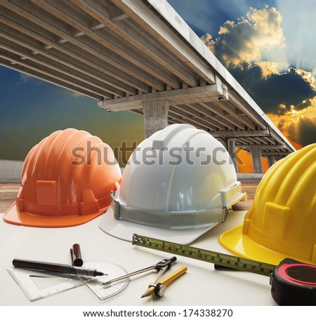 bridge crossing road junction and civil engineer working table use for urban infra structure and government  development topic and civil engineering ,real estate topic