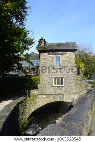 Bridge House stands over Stock Beck in the middle of Ambleside in the Lake District of England