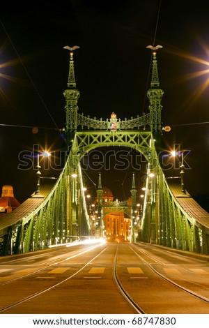 Bridge in Budapest, illuminated at night.