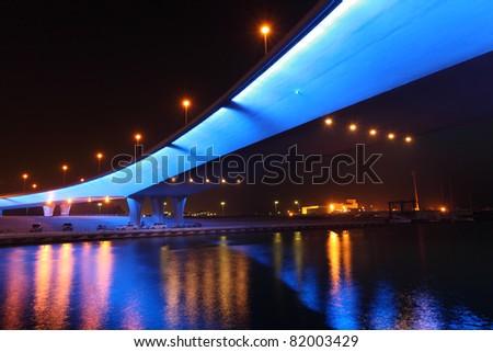 Bridge in Dubai Marina illuminated at night