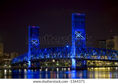 Bridge in Jacksonville, Florida, light up with blue lights at night.