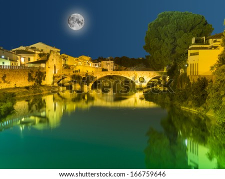 Bridge in Prato, Tuscany, Italy,  photographed at night under a full moon