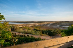 Bridge in Quinta do Lago, that leads to the beach and goes across Ria Formosa, in Algarve, Portugal