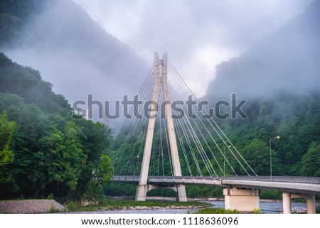 Bridge in the mountains with interesting supports. Engineering solution #1118636096