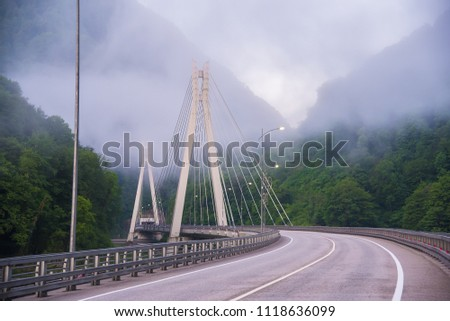 Bridge in the mountains with interesting supports. Engineering solution #1118636099