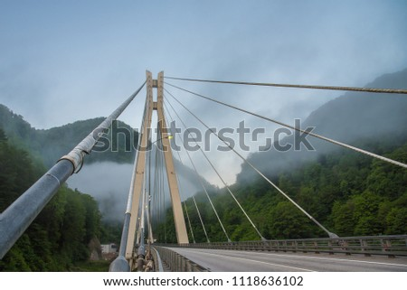 Bridge in the mountains with interesting supports. Engineering solution #1118636102