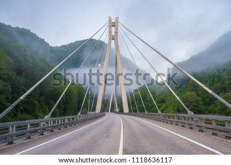 Bridge in the mountains with interesting supports. Engineering solution #1118636117