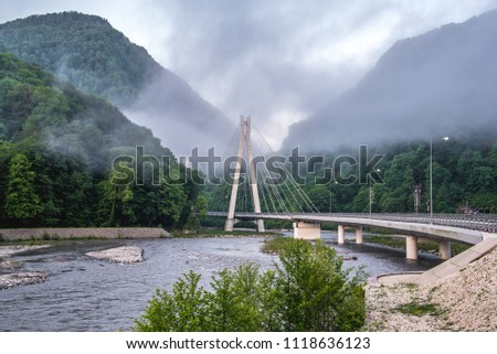 Bridge in the mountains with interesting supports. Engineering solution #1118636123
