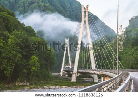 Bridge in the mountains with interesting supports. Engineering solution #1118636126