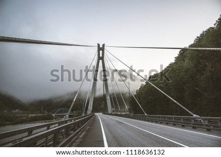 Bridge in the mountains with interesting supports. Engineering solution #1118636132