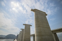 Bridge is under construction on the river in China.