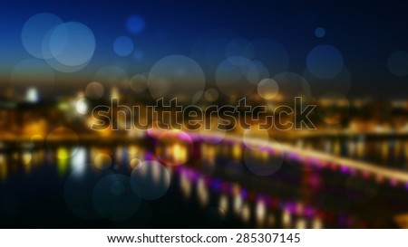 Bridge lights with night river reflection and light circles