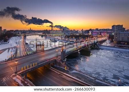 Bridge of Bogdan Khmelnitsky, Borodinsky bridge on Moskva river in winter evening in Moscow, Russia